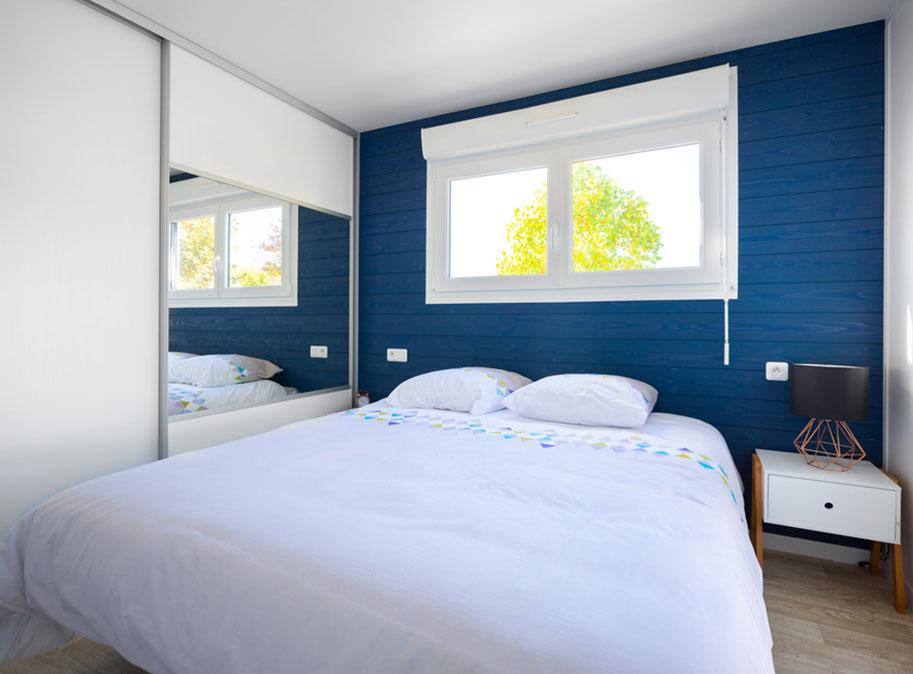 Chambre parentale - chalet en bois 50 m² habitable tout équipé